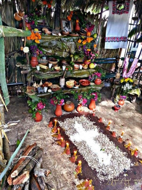 an altar set up on a grave during the day of the dead in Mexico