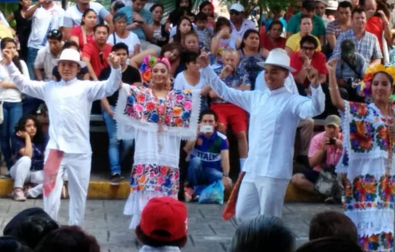 folk dancing in the main square Centro Merida in their embroidered dresses