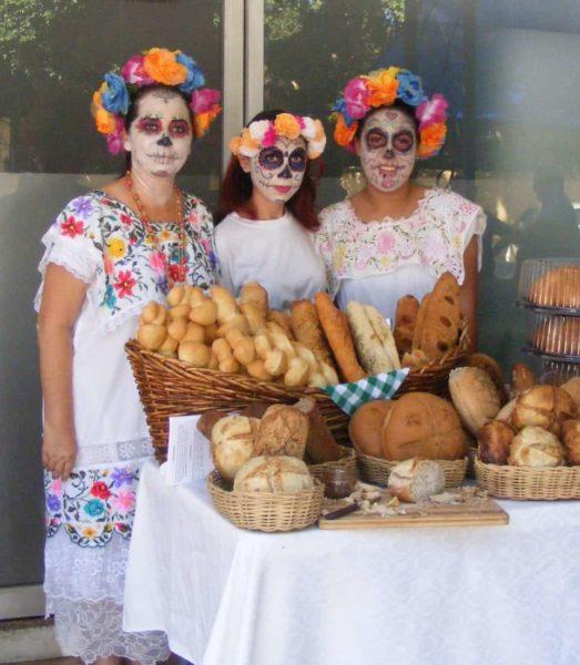 selling bread in full makeup in Santa Lucia Park