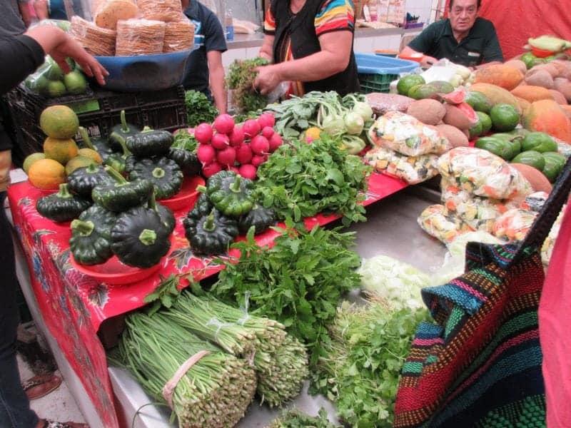 vegetable sellers inside the Lucas Galvez Market in Merida