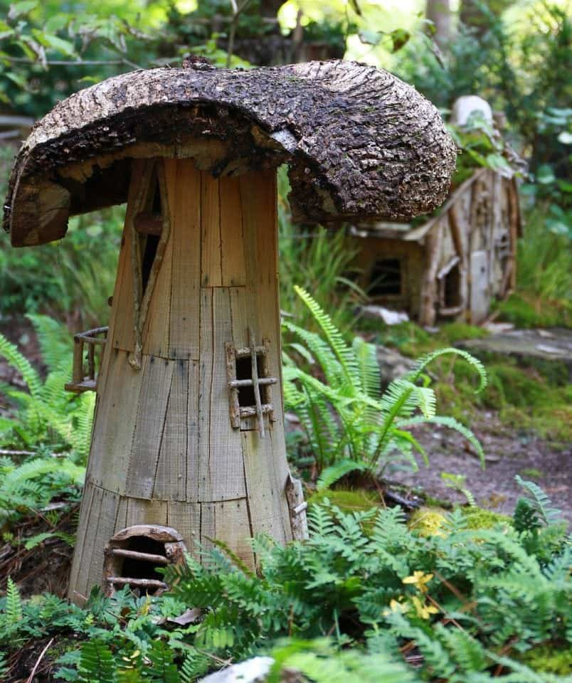 disguised to look like a mushroom this little fairy house is tucked into a fairy garden in Ireland