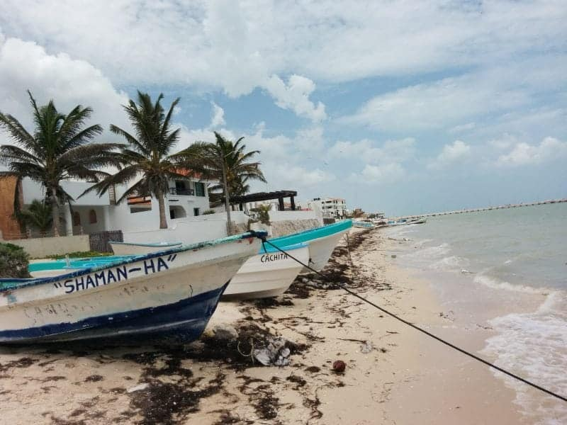 fishing boats on the beaches living the expat life in the Yucatan
