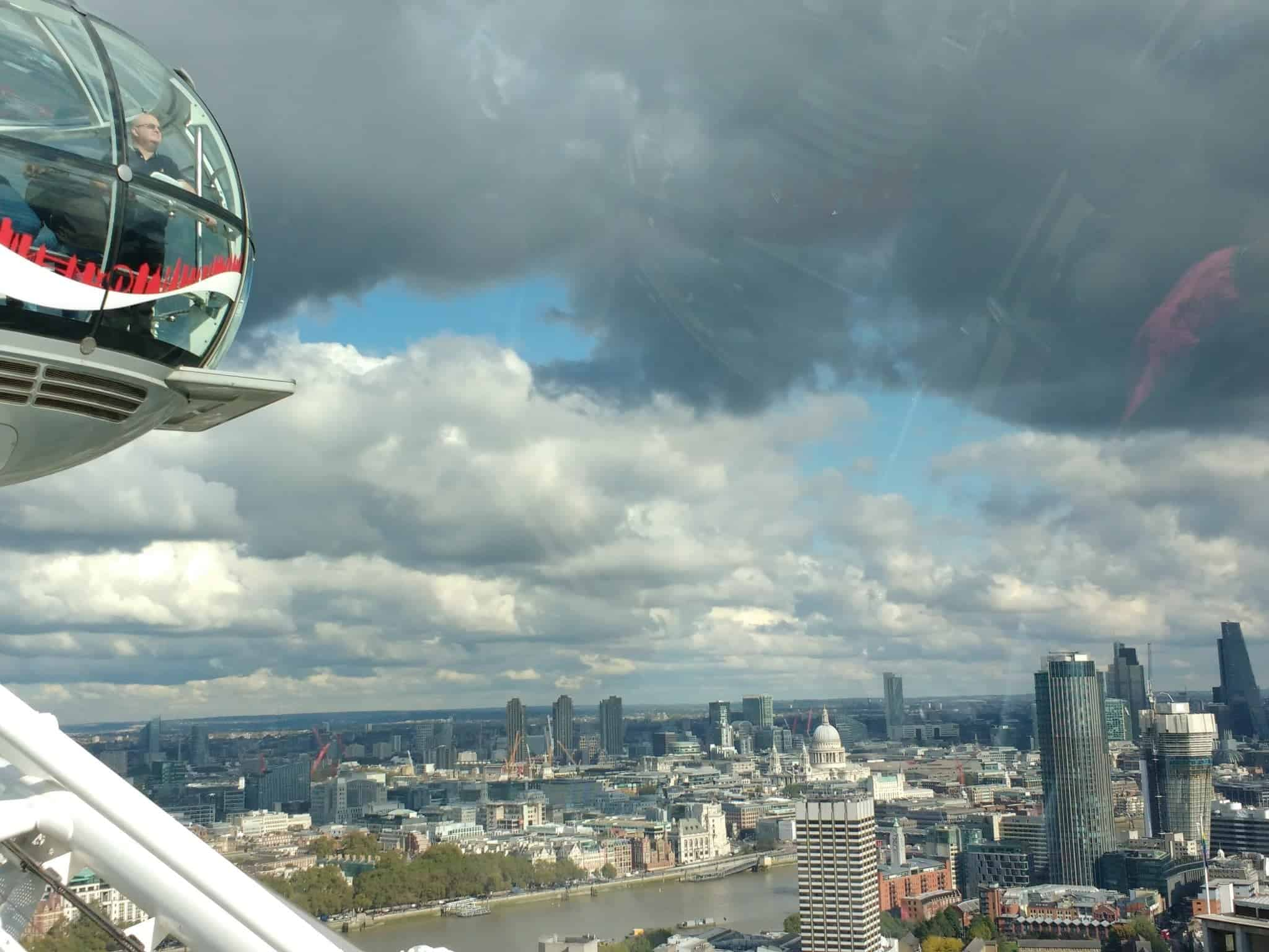 view of a capsule of the London Eye and the City beyond