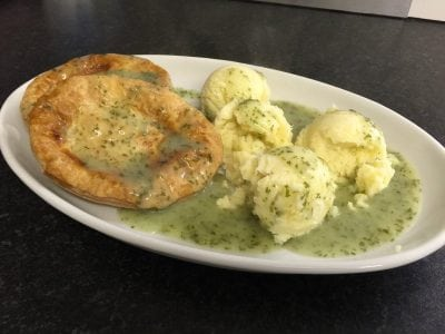 a plate of pie, mash and liquor