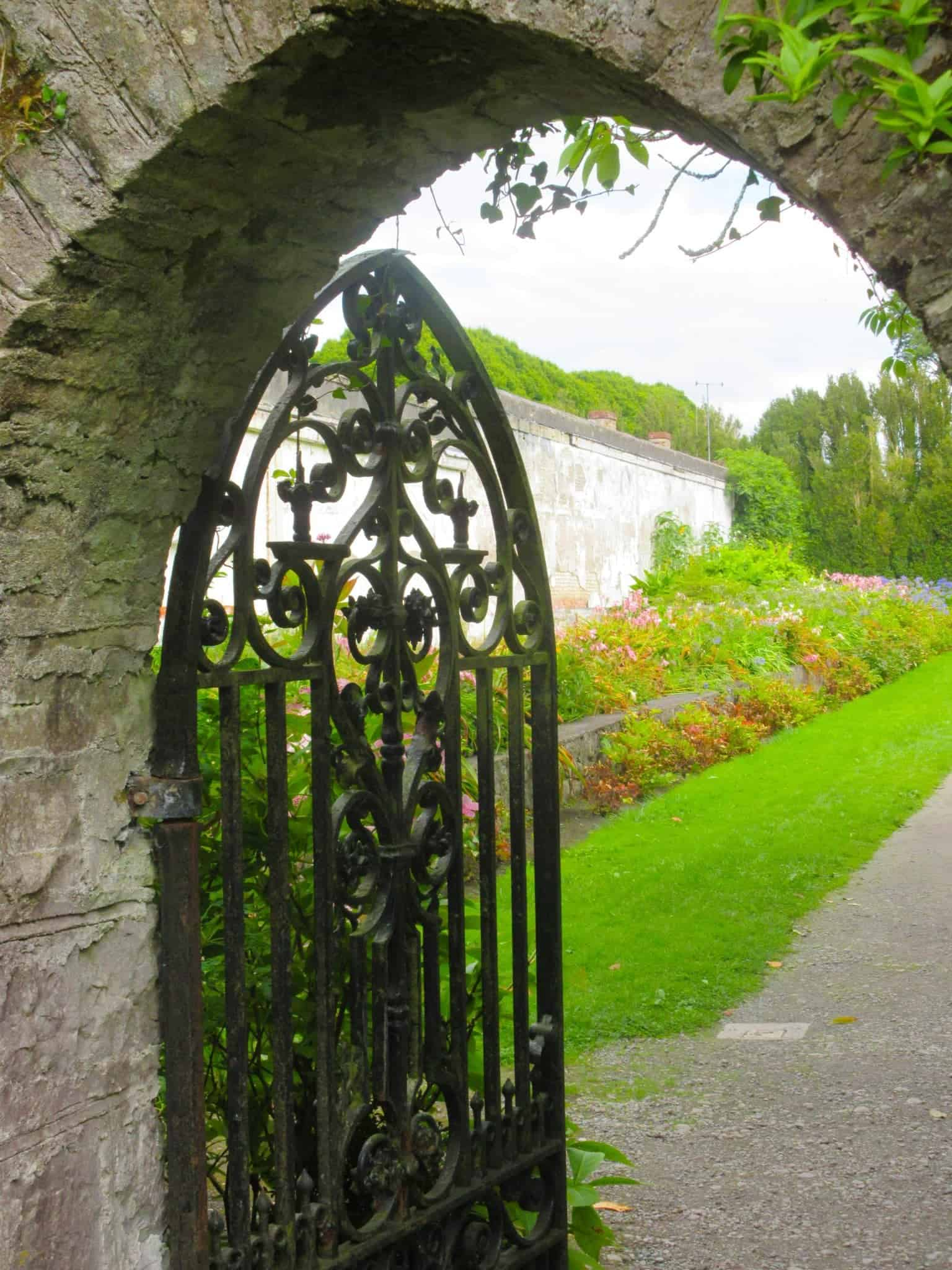the beautiful wrought Iron gate that leads to the secret gardens of Birr Castle a must see when traveling Ireland