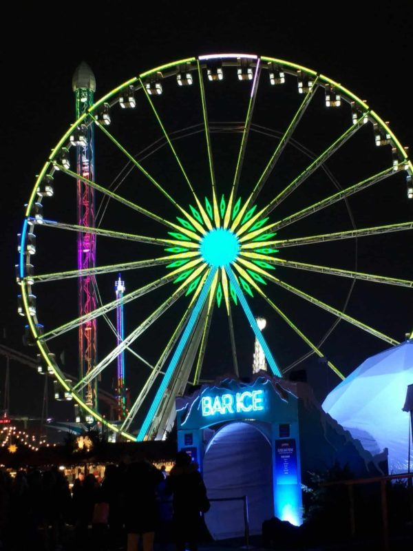the giant ferris wheel at Winter wonderland in Hyde Park set up for Christmas in London