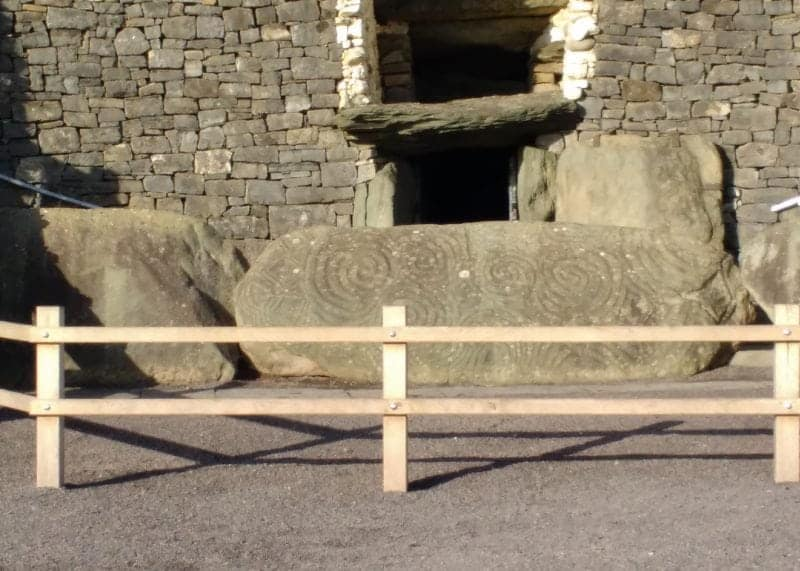 entry stone at Newgrange with carved motifs