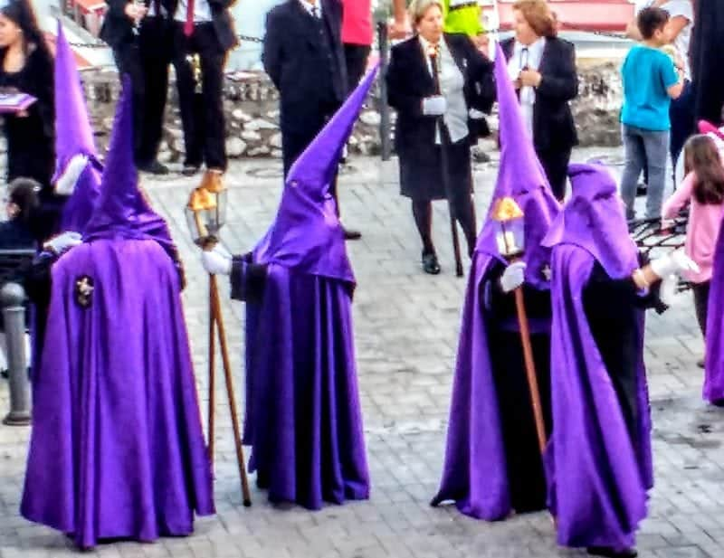 penitents getting ready for the procession during Semana Santa