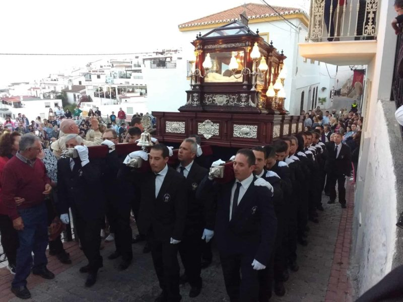 cofradia or brotherhood carrying a float in the Semana Santa parade