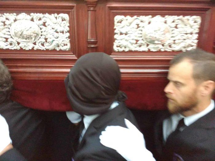 masked penitent in Salobrena carrying the Semana Santa Tronos