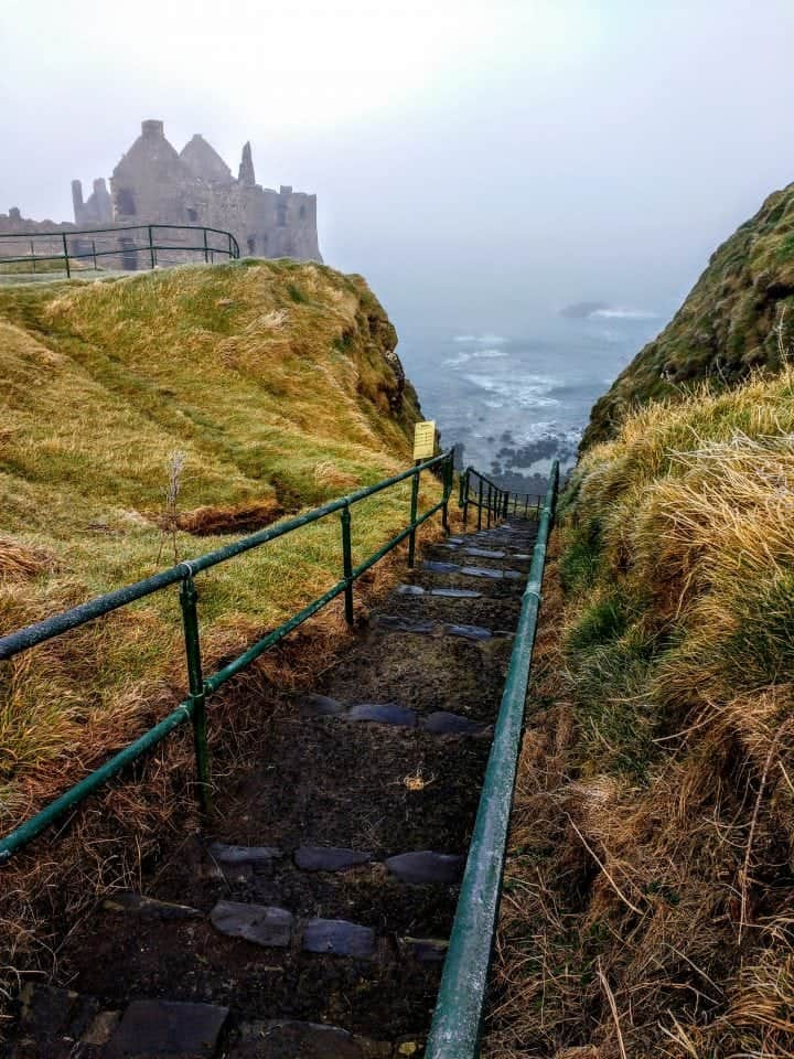 the Haunted castle of Dunluce in Ireland. The mist from the Atlantic covers the sea and the ruins of Dunluce are haunted with the screams of the kitchen staff that plummeted into the sea.