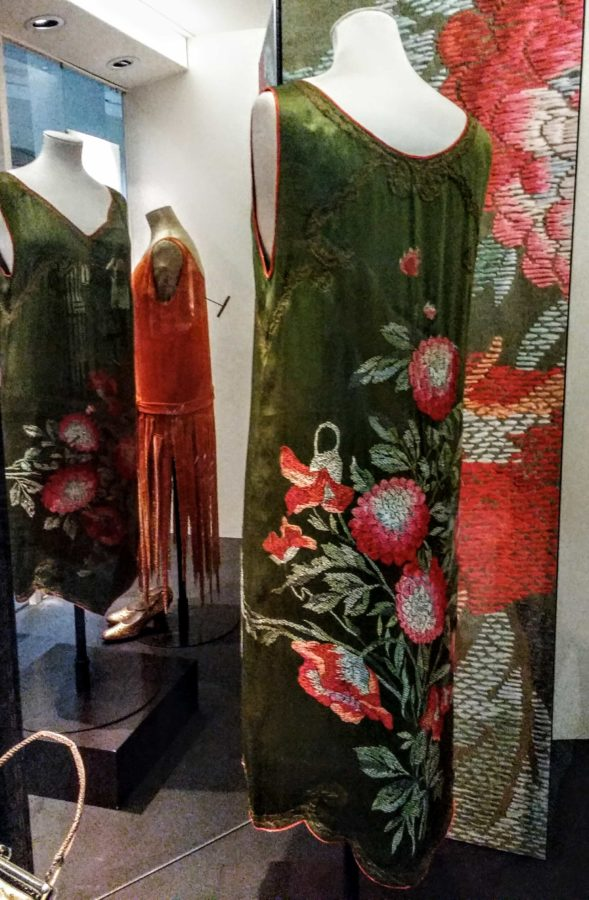 a gorgeous velvet embroidered dress in greens and corals at the V&YA