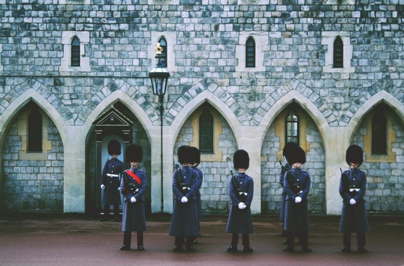 guards in bearskin hats guarding the Queen's Palace at Windsor Castle
