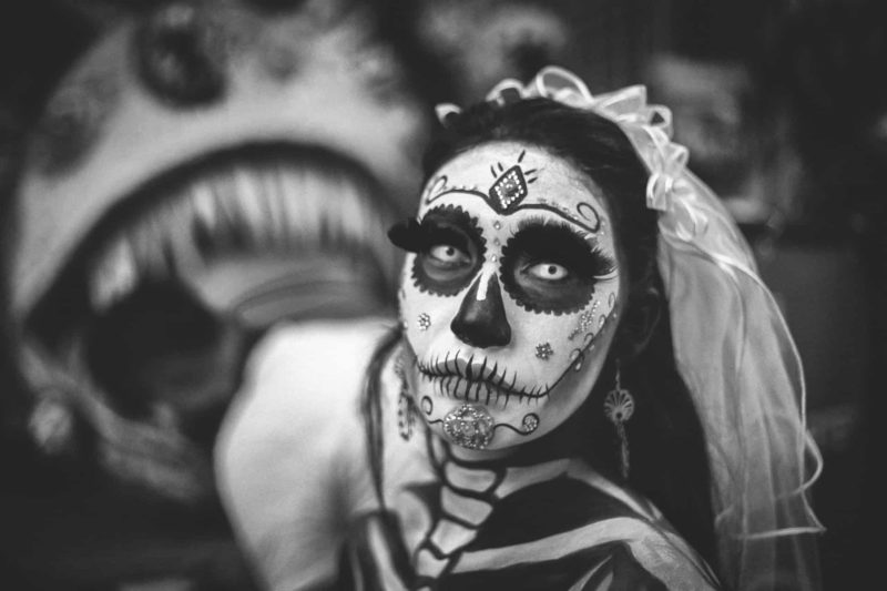 face painted to look like a calavera in Mexico