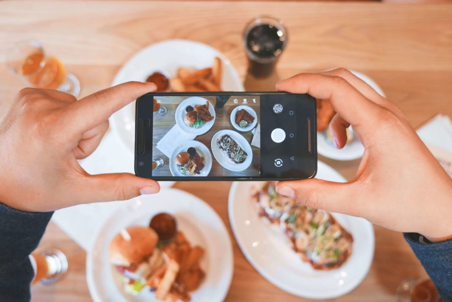 a travel blogger photographing their food, not unusual in most restaurants around the world we foodies travel for unusual food