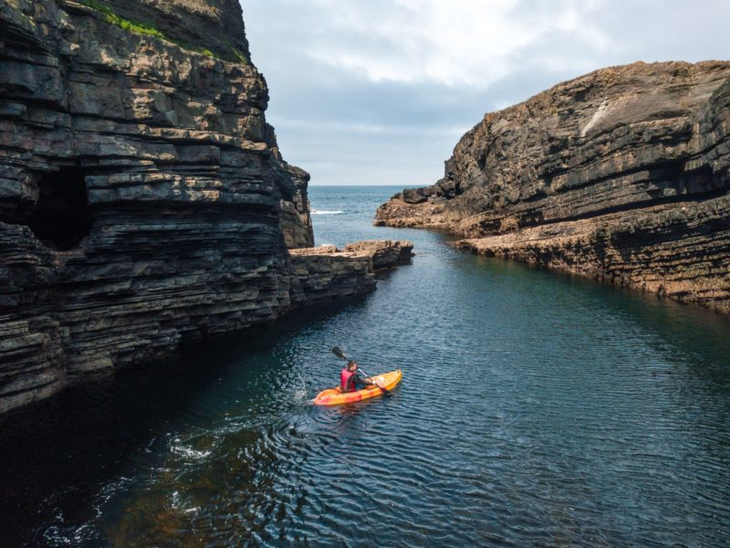 travel to Ireland and go kayaking around the rocks at Dun Briste magical