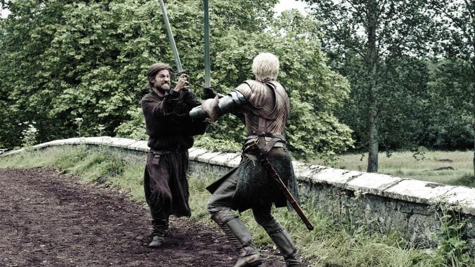 Jamie and Briene fighting on the bridge near Randlaston