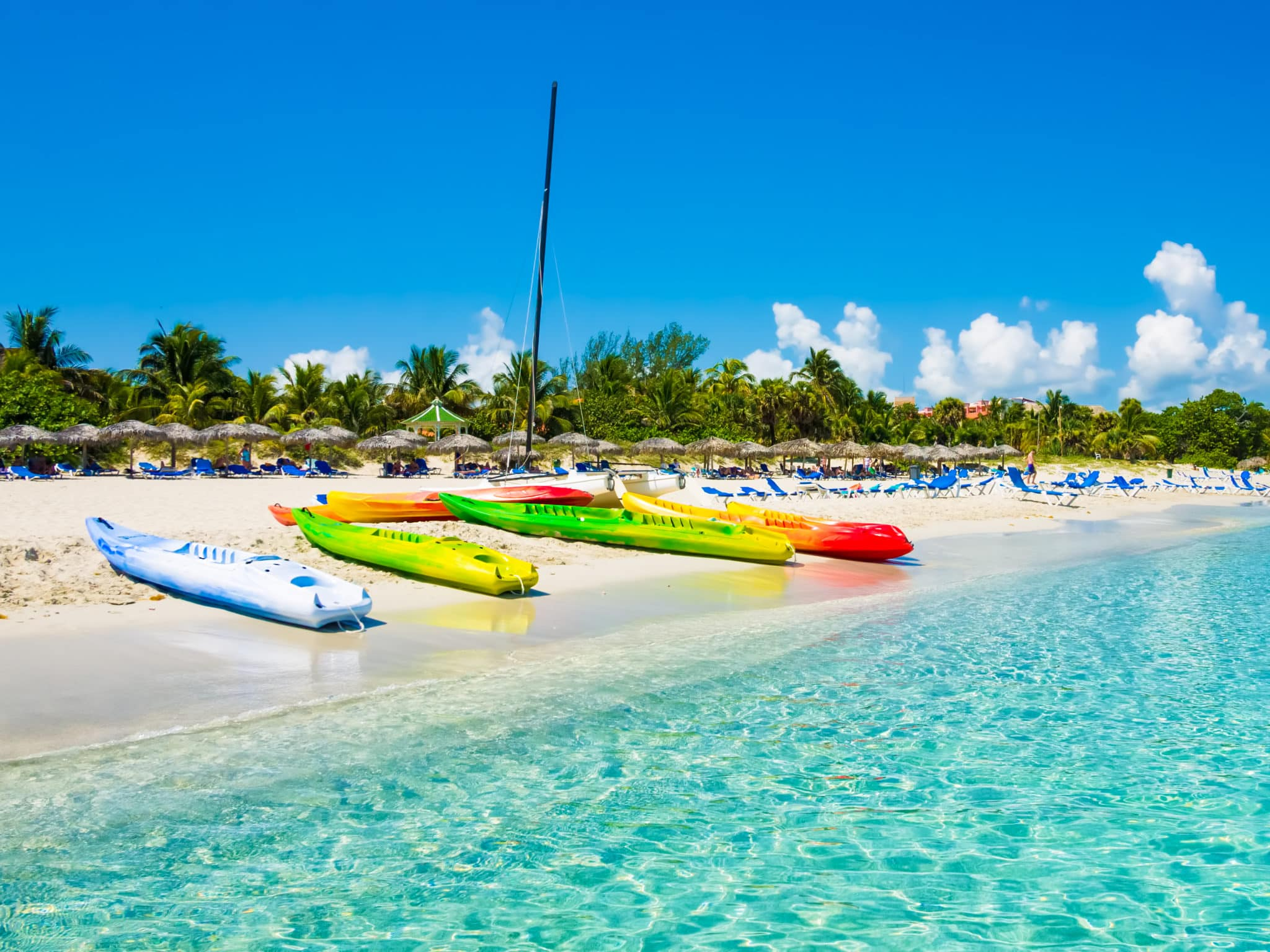 Kayaks and sailing boats on the beautiful beach of Varadero in Cuba (image taken from the sea) one week in Cuba