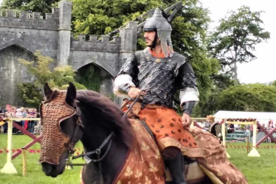 Jousting knight on horseback at the Birr Castle Game fair in Ireland's ancient East and the Hidden heartlands