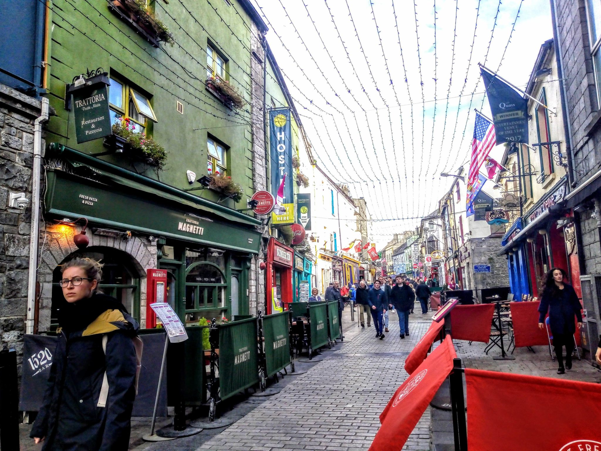 Galway city with shops bars and poeple