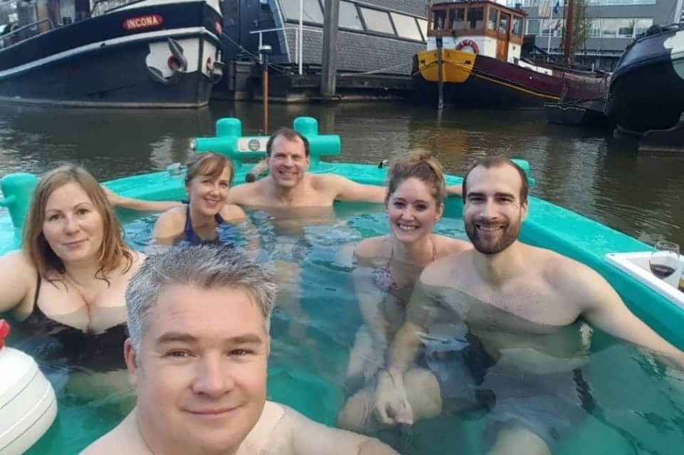 hot tubbing boat on the canals of the Netherlands