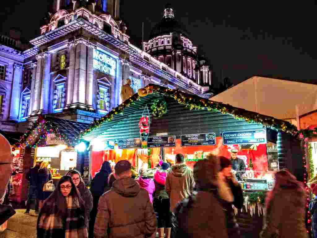 Belfast Christmas Market all lit up in the evening