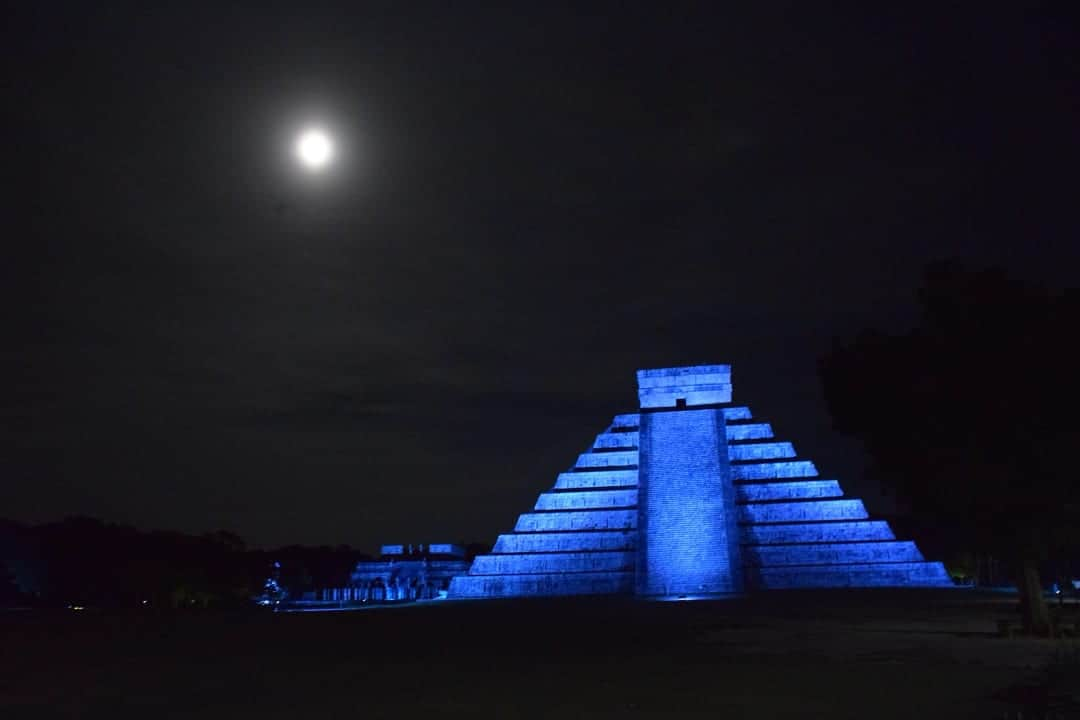 Chichen Itza lit up in blue at night under a full moon top-six-things-to-do-in-mexicos-yucatan-peninsula