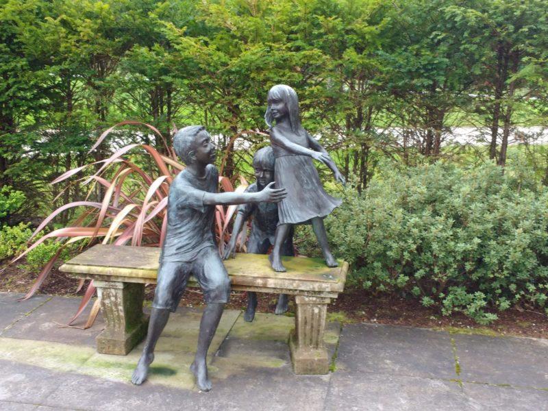 garden sculpture of children playing at Lough Eske Castle