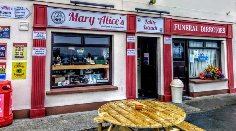 shop front of Mary Alice's cafe in Church Hill, sign says cafe and funeral directors Glenveagh Castle