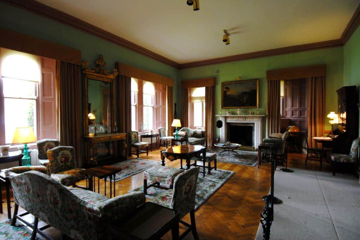the formal drawing room at Glenveagh Castle deep shades of emerald green