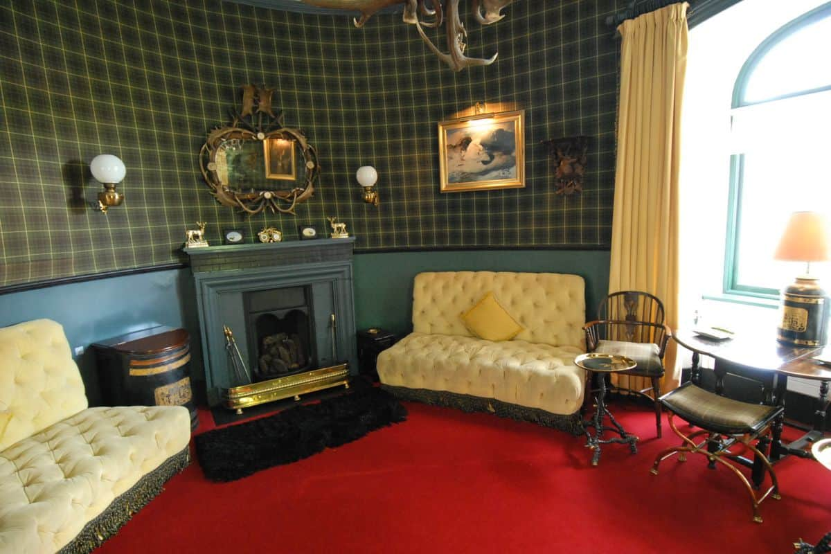 to match the Balmoral style of castle this little gentlemans room is decorated in tartan