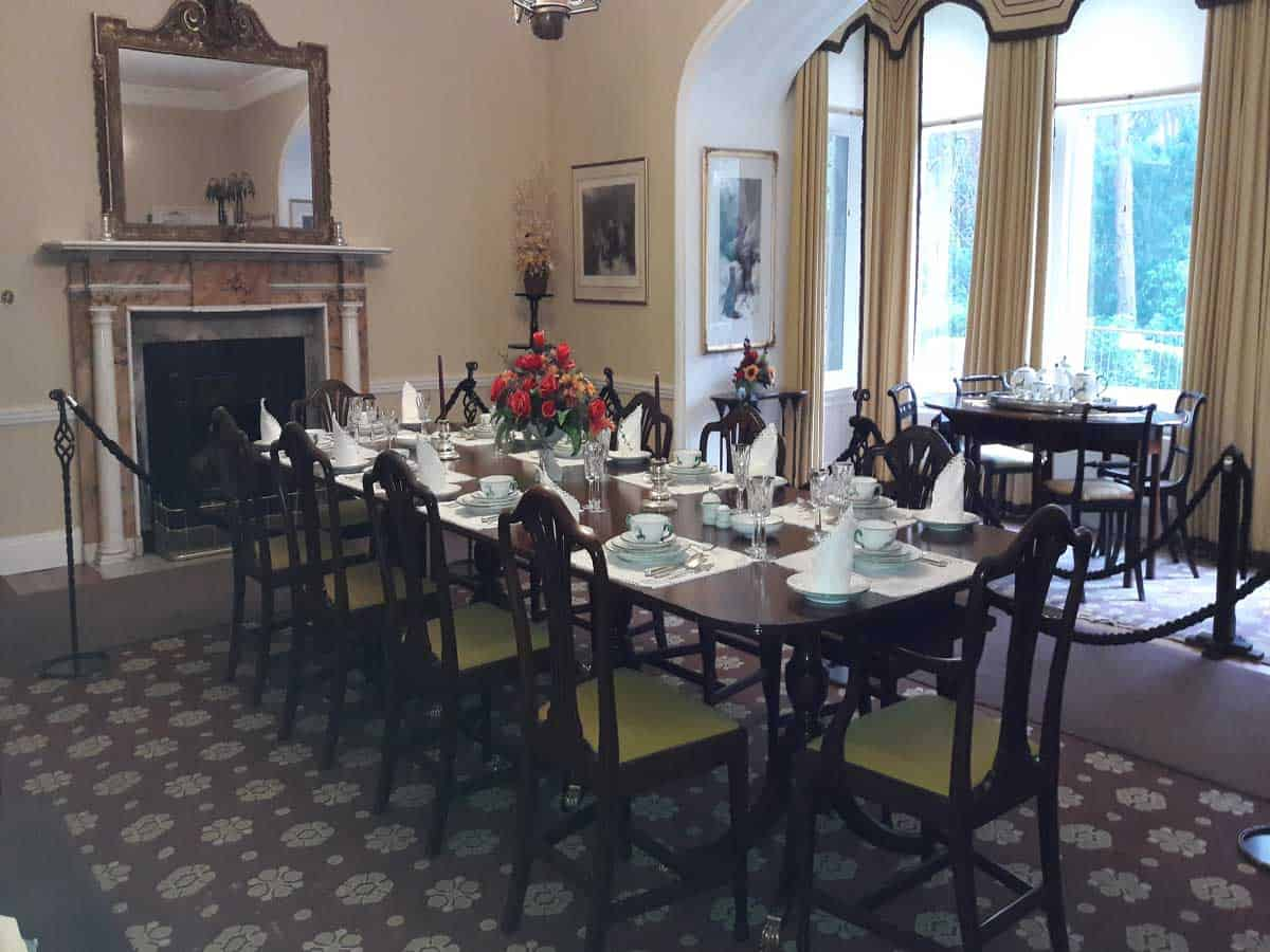 a large grand dining room at Glenveagh Castle set for dinner