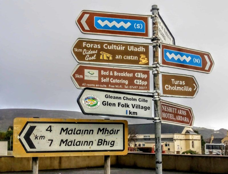a signpost full of signs for the Wild Atlantic Way, Glencolmcille, and other ares you must see in Donegal