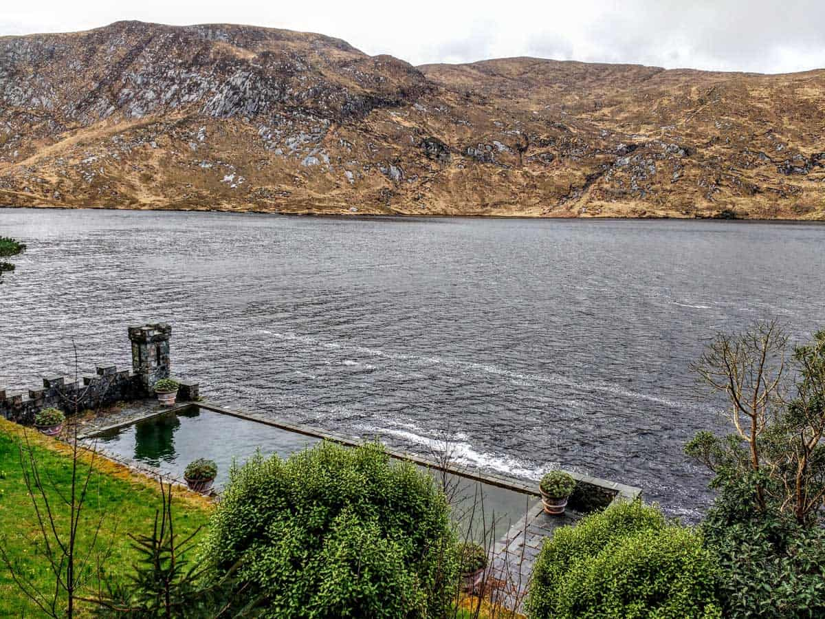 a view of Loch Veagh and the outdoor heated swimming pool at Glenveagh Castle that Marilyn Monroe swam in
