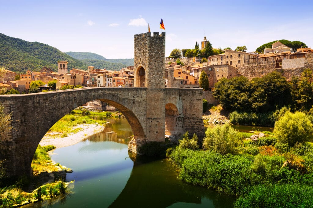Medieval bridge with antique gate, built in the 12th century. Besalu, Catalonia