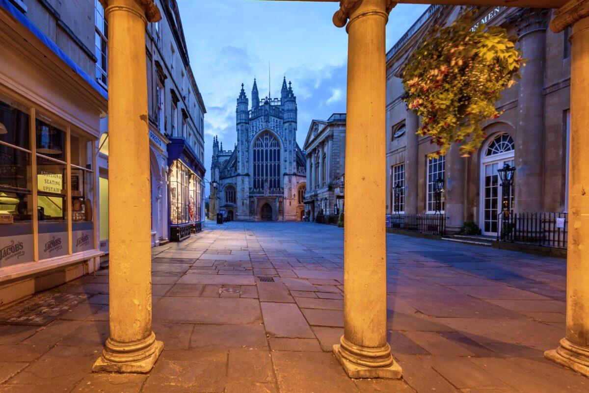 Bath Abbey viewed through the roman pillars, Bath city, UK.