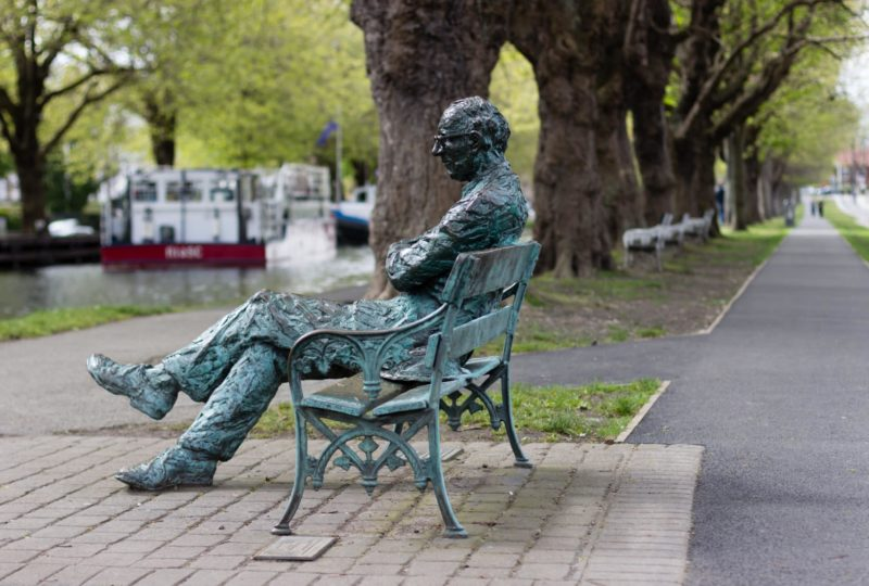 one of Dublin's many statues, man on a park bench