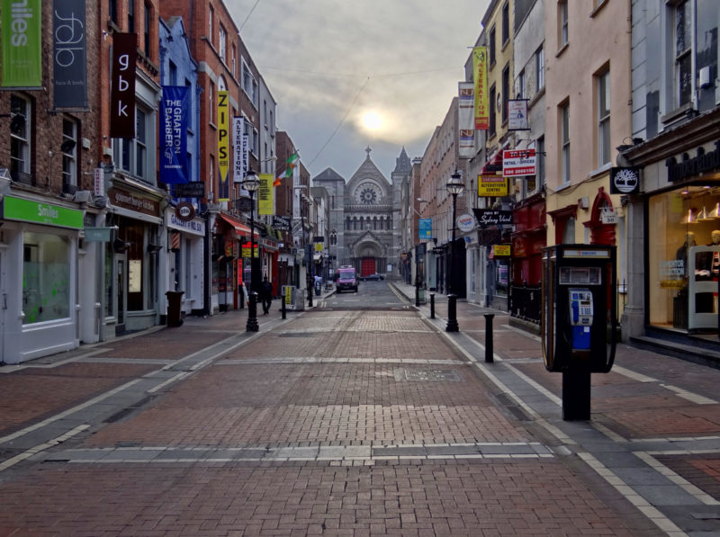 road trip Ireland a view of Dublin at twilight on a city street with Church at far end