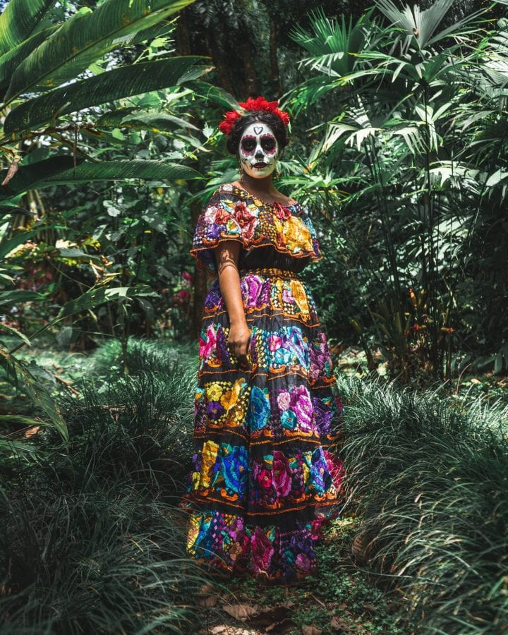 La Catrina in the woods of Mexico with a calavera painted face