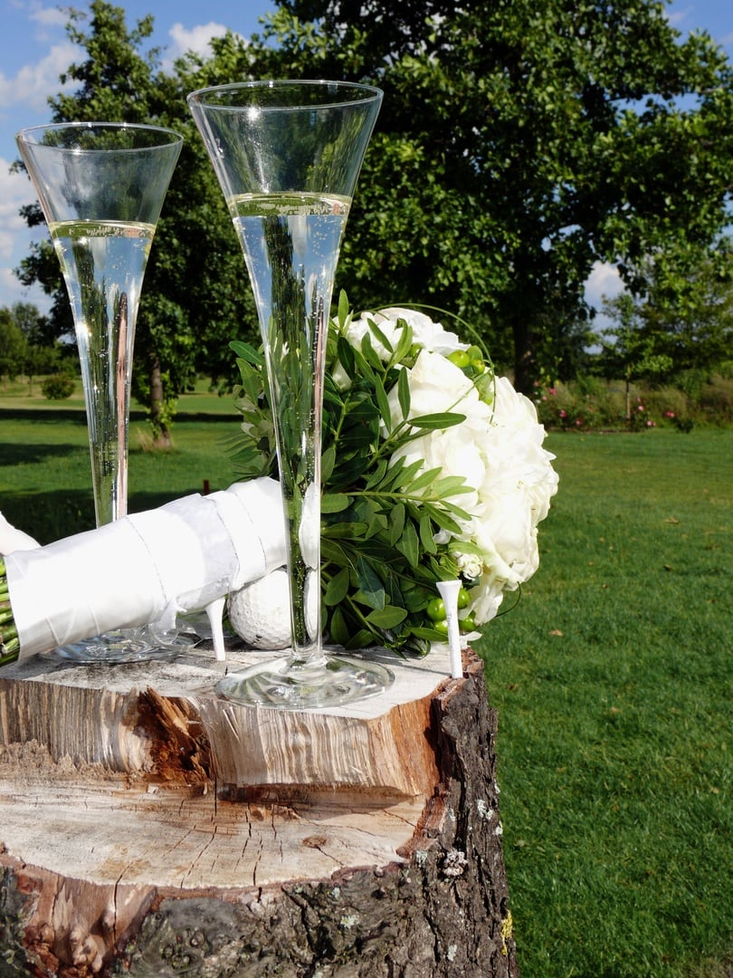 getting married in Ireland a ceremonial glass of champagne in an Armagh apple orchard