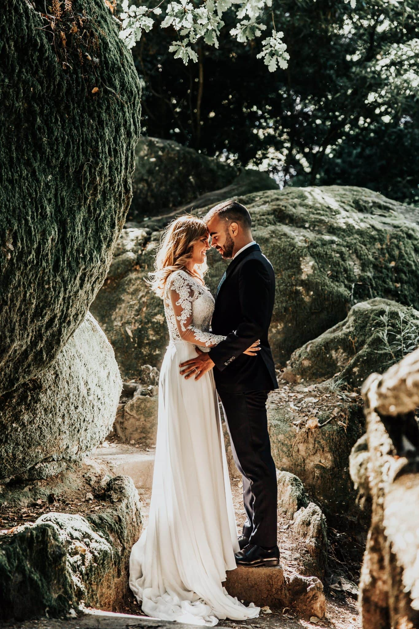 married couple photo on the boulders and stones of the lake