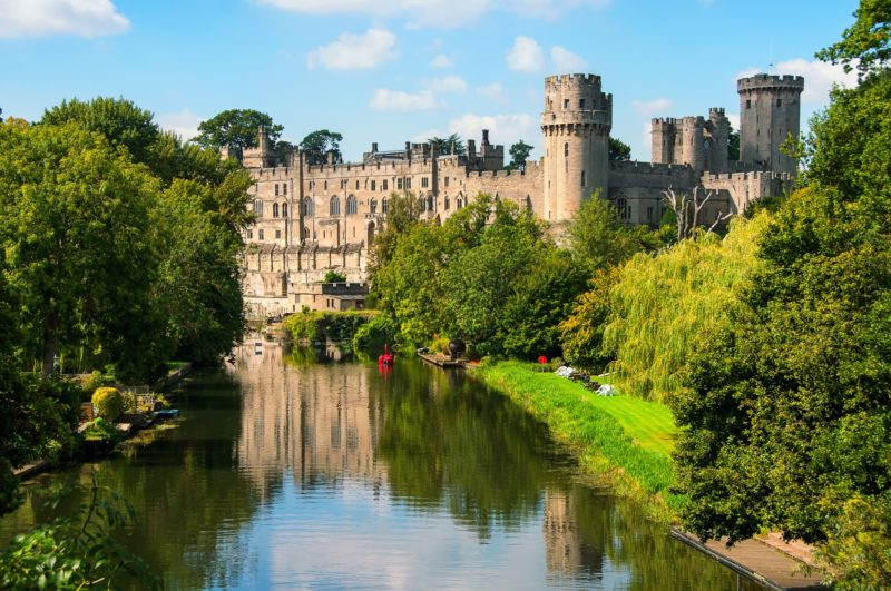 view of Warwick Castle from the riverbank