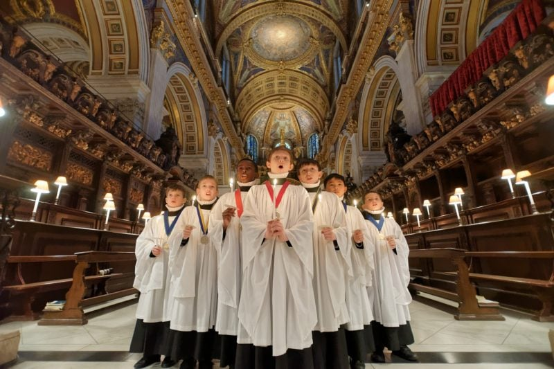 St. Pauls Christmas Card available in the shop a group of choir boys singing in the cathedral of St. Pauls
