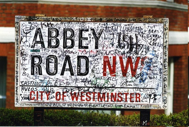 graffitti covered Abbey Road street sign