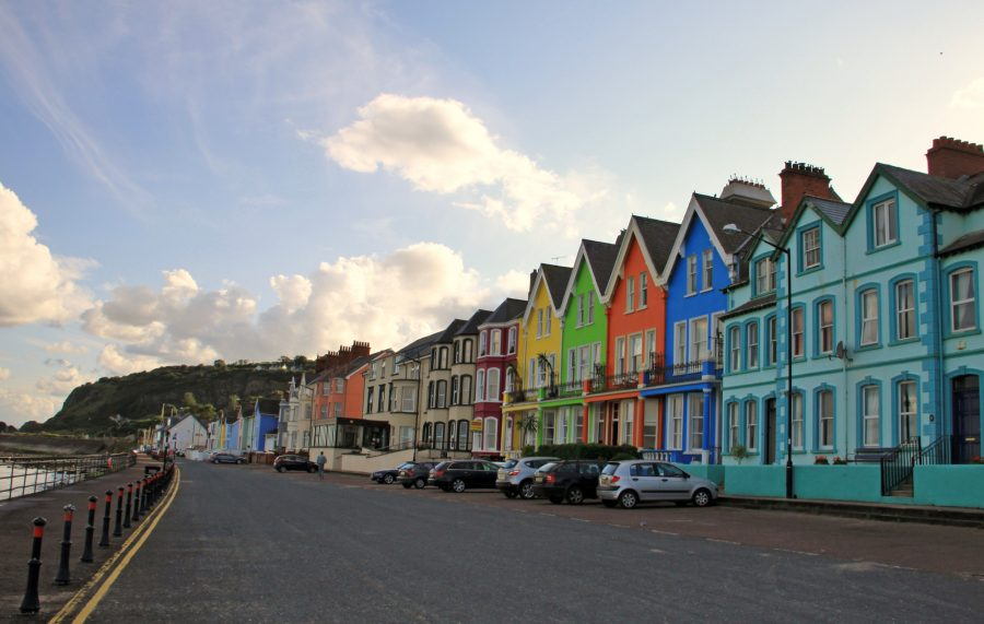 Small village on Antrim coast with coloured houses, Northern Ireland, United Kingdom