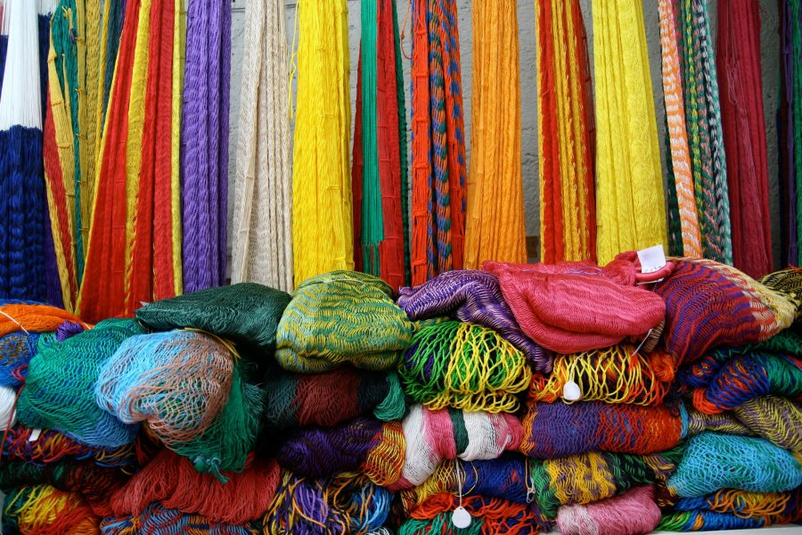 beautiful bright coloured hammocks folded up and for sale at Ebtun Mexico