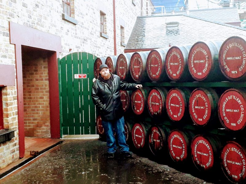 Hanging out at Bushmills Distillery in N. Ireland - whiskey casks outside the distillery
