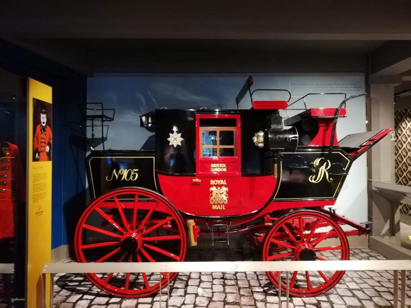 an antique postal carriage in the Museum of Postal History in London