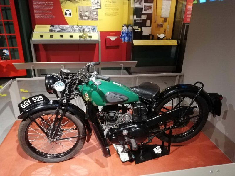 a beautiful mint green motorcycle used to carry the Royal Mail during the War in London's Postal Museum