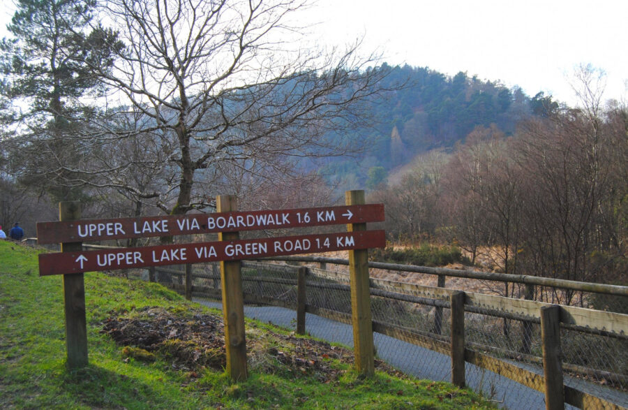 Signs for walks in Glendalough national park Ireland